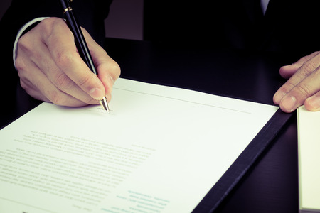businessman signing marketing contract. Banco de Imagens - 40809225