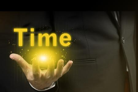 businessman showing time word.marketing concept. Archivio Fotografico
