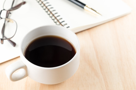 cofffee: cup of cofffee and pen on notebook