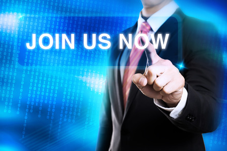 businessman click on Join us now Standard-Bild