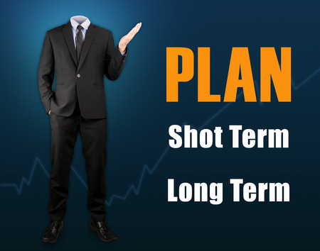 long term: Businessman with business plan shot term and long term