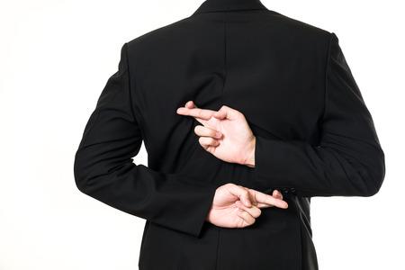 Businessman cross his finger on white background