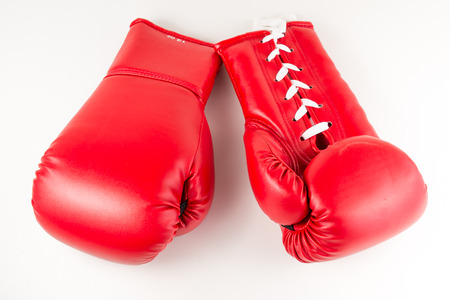 boxing: red leather boxing gloves on white isolated background