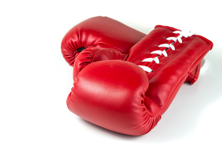 boxing knockout: red leather boxing gloves on white isolated background