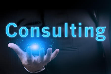 business services: Businessman hand holding Consulting word