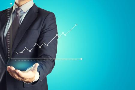 Businessman Holding investment business graph Archivio Fotografico