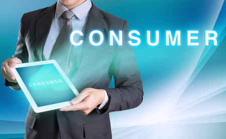 consumer: businessman holding computer tablet in hand and show CONSUMER Stock Photo