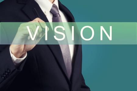 Businessman writing Vision Word Archivio Fotografico