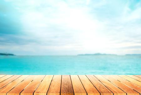 wooden platform and blur tropical beach