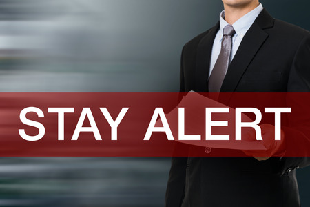 to stay: Businessman with Stay Alert Word