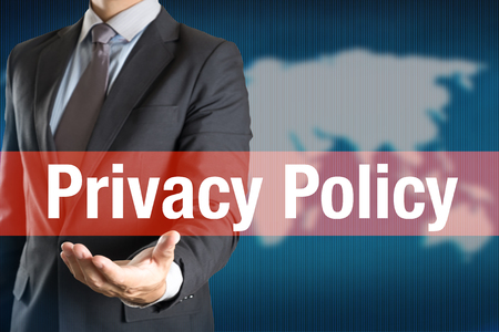 technology agreement: Businessman holding PRIVACY POLICY word with world background