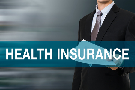 health and safety: Businessman with HEALTH INSURANCE WORD