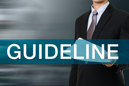 guideline: Businessman with GUIDELINE WORD Stock Photo