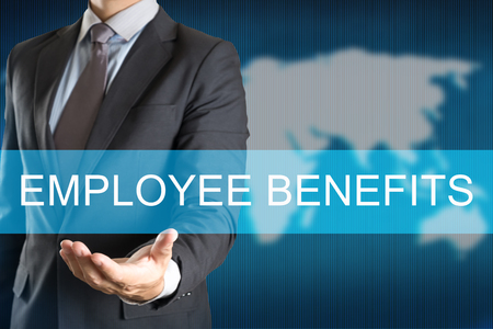 Businessman holding with EMPLOYEE BENEFITS WORD