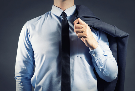 his: Businessman holding his suit Stock Photo