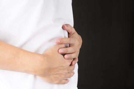 stomachache: Man having a stomachache Stock Photo