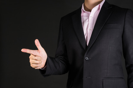 his: business man points his finger