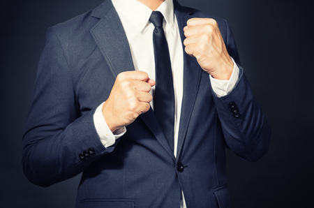 Businessman in suit doing fighting stance