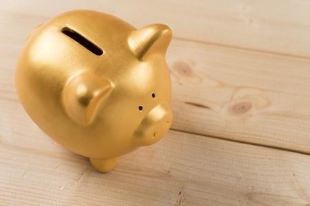 Gold piggy bank for Saving money. Banco de Imagens - 54932480