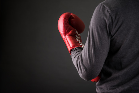 work gloves: man with boxing gloves .Photo for magazine ,or design work Stock Photo