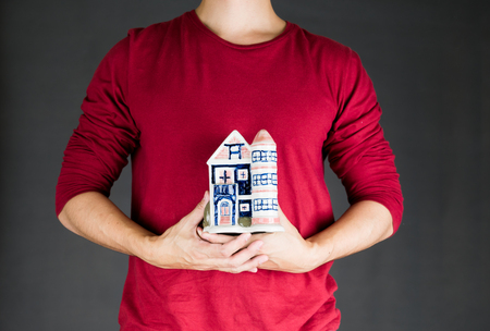 real estate investment: man holding house .real estate investment concept Stock Photo