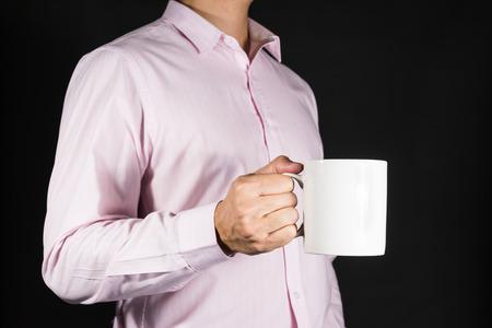 mug of coffee: Businessman Holding coffee mug with copy space Stock Photo