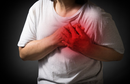 Old women holding his heart in pain