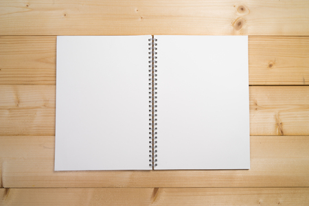 note booklet: Open book on wooden table with copy spave Stock Photo