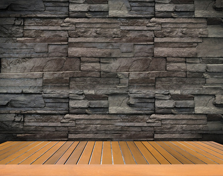 dark backgrounds: Black Brick wall background and wooden floor plate. Stock Photo