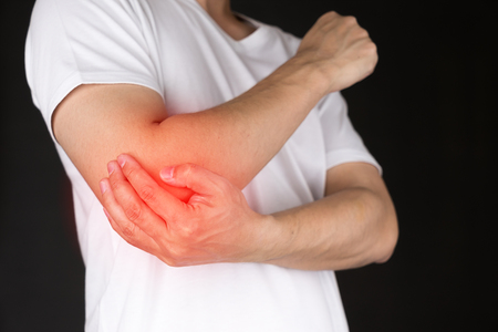 Man with elbow pain 스톡 콘텐츠
