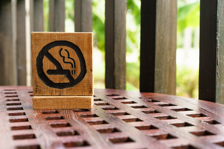 non-smoking sign on wooden table Stock Photo