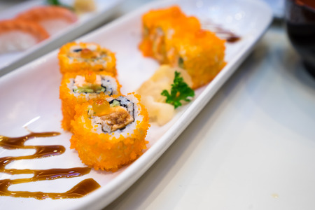 california roll: Selective focus point Sushi california roll with tuna