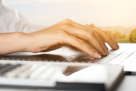 working hands: Women hand working on laptop computer Stock Photo