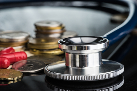 Stethoscope money and pill .medical fee concept