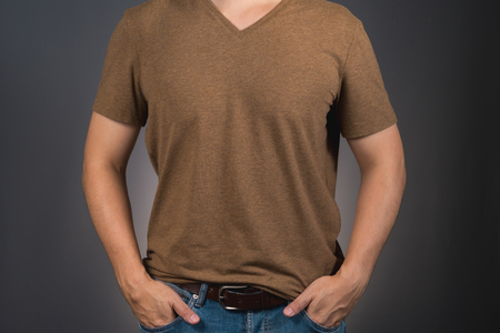 asian man pose on brown t-shirt with copy space Imagens