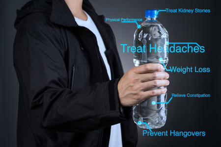 Asian sport man holding bottle with benefit of drinking water description