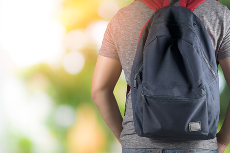 Asian man on Gray T-shirt holding study book and carry school bag .back to school concept Imagens