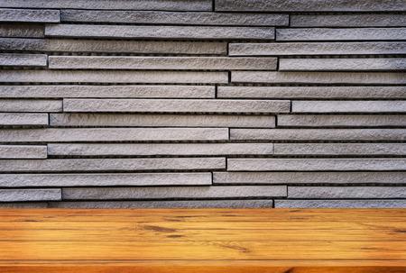 Gray brick wall with wooden floor for design work 写真素材