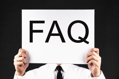 Businessman holding FAQ Board Sign