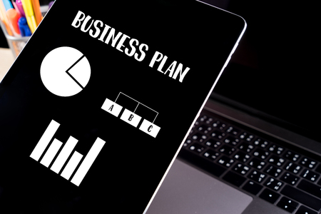 Tablet with Business plan on screen Imagens