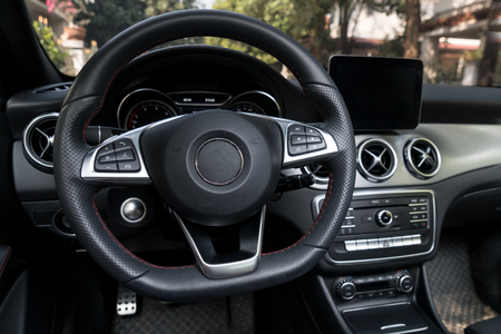 Steering wheel in modern sport car with radio controller