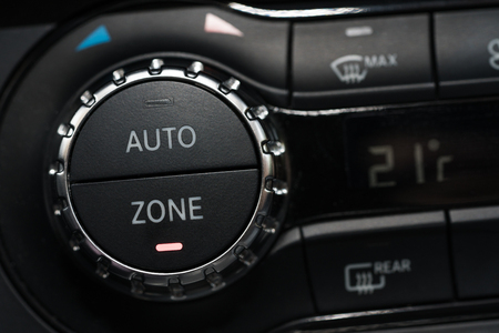 Auto Air Conditioning button in sport car