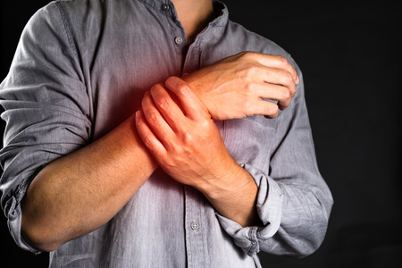 asian man doest feel good on wrist pain