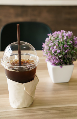 Ice Americano Black coffee on wooden table at cafe