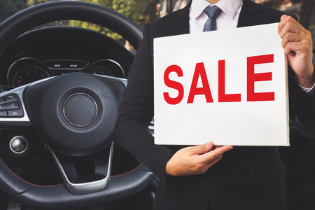 Businessman SALE a Sport Car