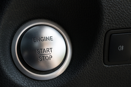 Closeup at car engine start button Imagens