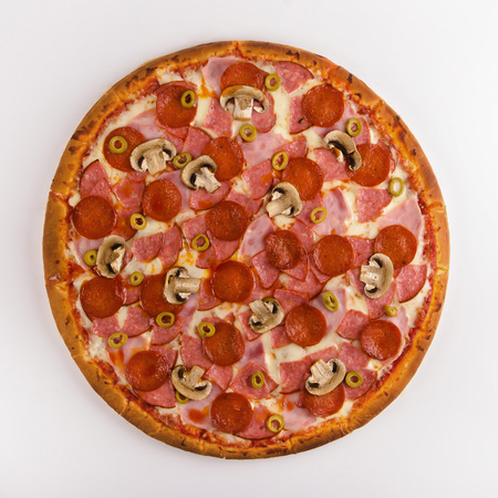Pizza mushrooms, salami, pepperoni, ham Standard-Bild