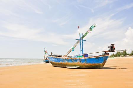 Wooden fishing boat on the beach photo
