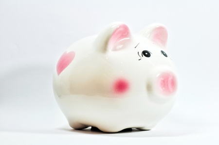 a piggy saving box on white background Stock Photo - 13184481