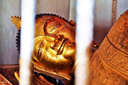 japanesse: Old buddha image in the prison  at Wat Phra Kaeo Don Tao ,Lampang ,Thailand